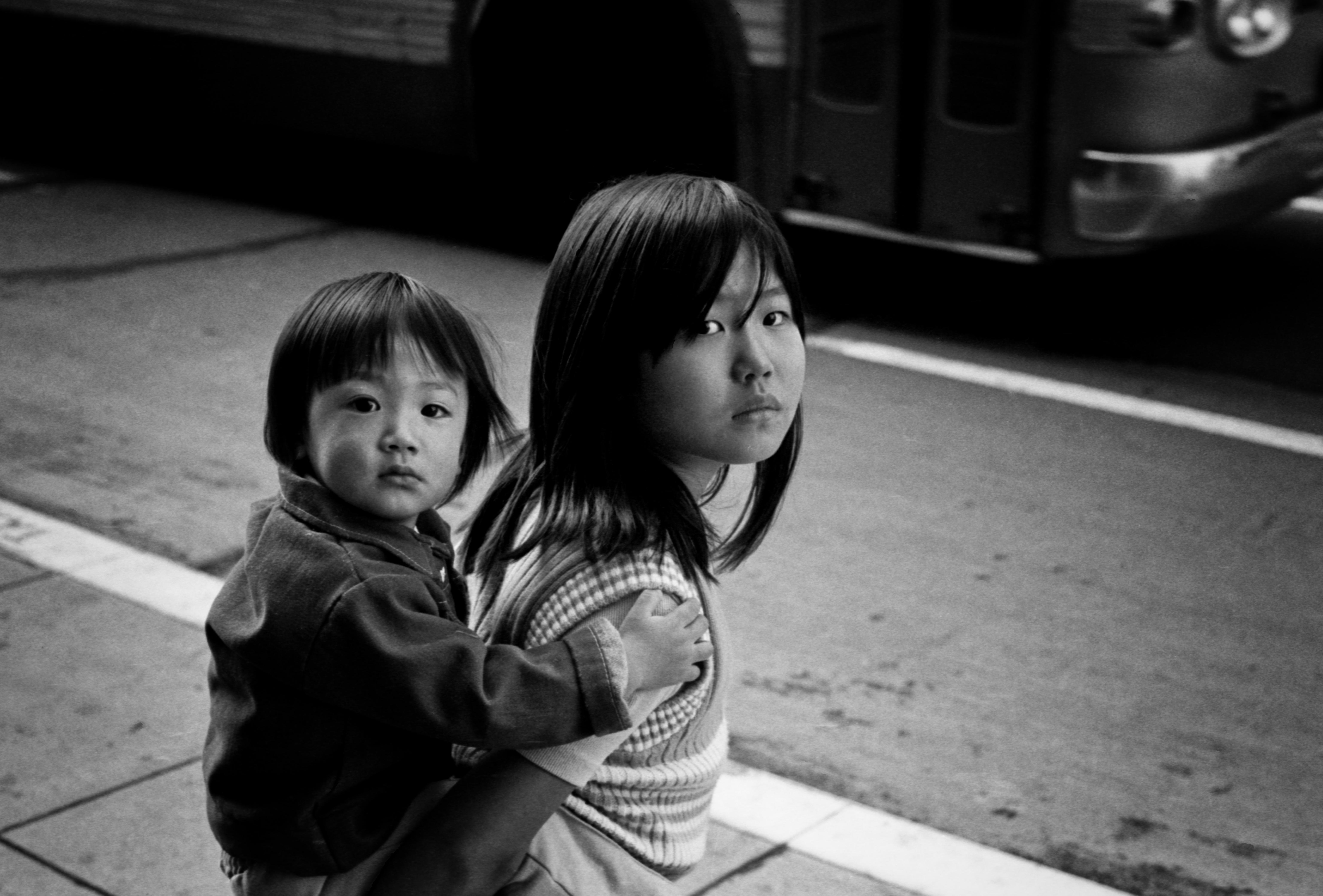Children nude on camera Two Oriental Children copyright 1971 Daniel D. Teoli Jr.