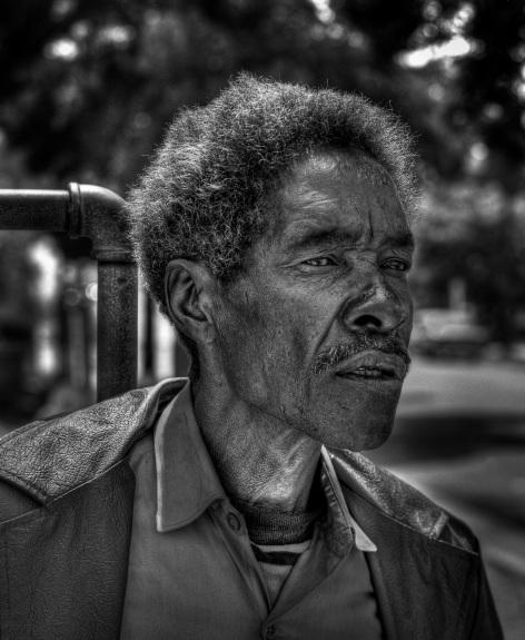 Man at Park copyright 1972 Daniel D. Teoli Jr. mr