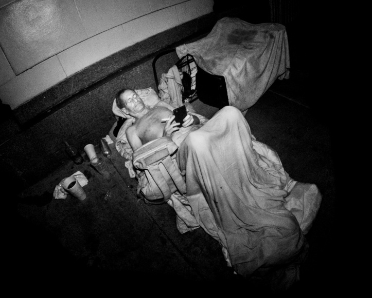 Homeless man with cell phone - infrared flash Hollywood, CA 2015 Daniel D. Teoli jr.
