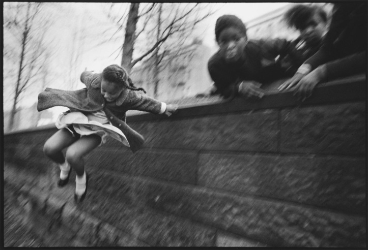 Mary Ellen Mark - Girl jumping over a wall