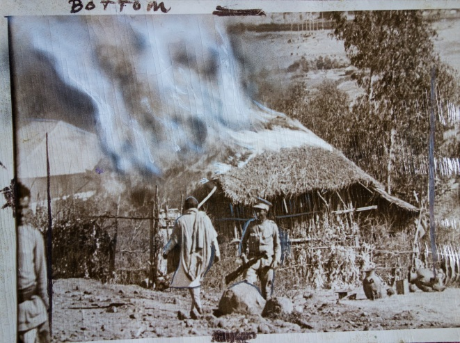 Doctored press photo showing flame and smoke drawn and painted in