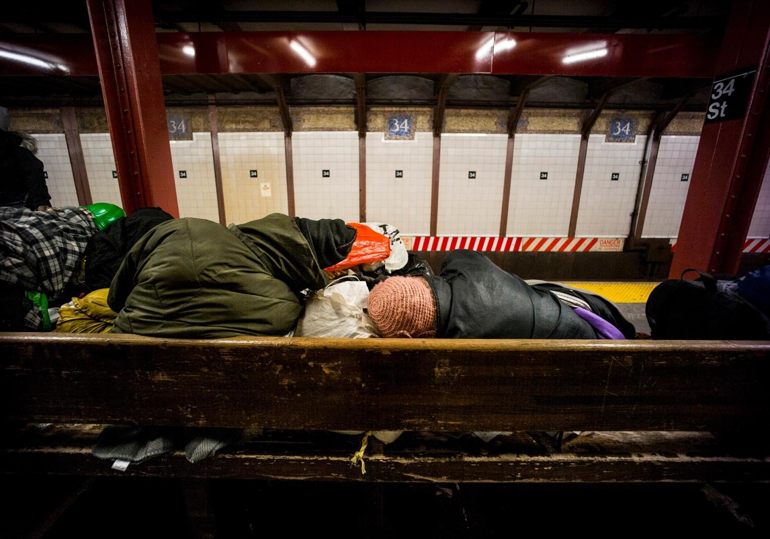 homeless-sleeping-on-bench-subway-nyc-2016-daniel-d-teoli-jr